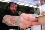 Action Bronson serving his poutine at SXSW (Photo by Kevin Bronson)